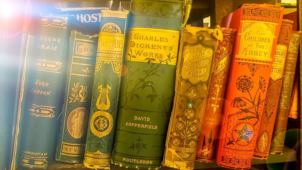 William Faulkners' bookshelf with Charles Dickens's Works in the center.